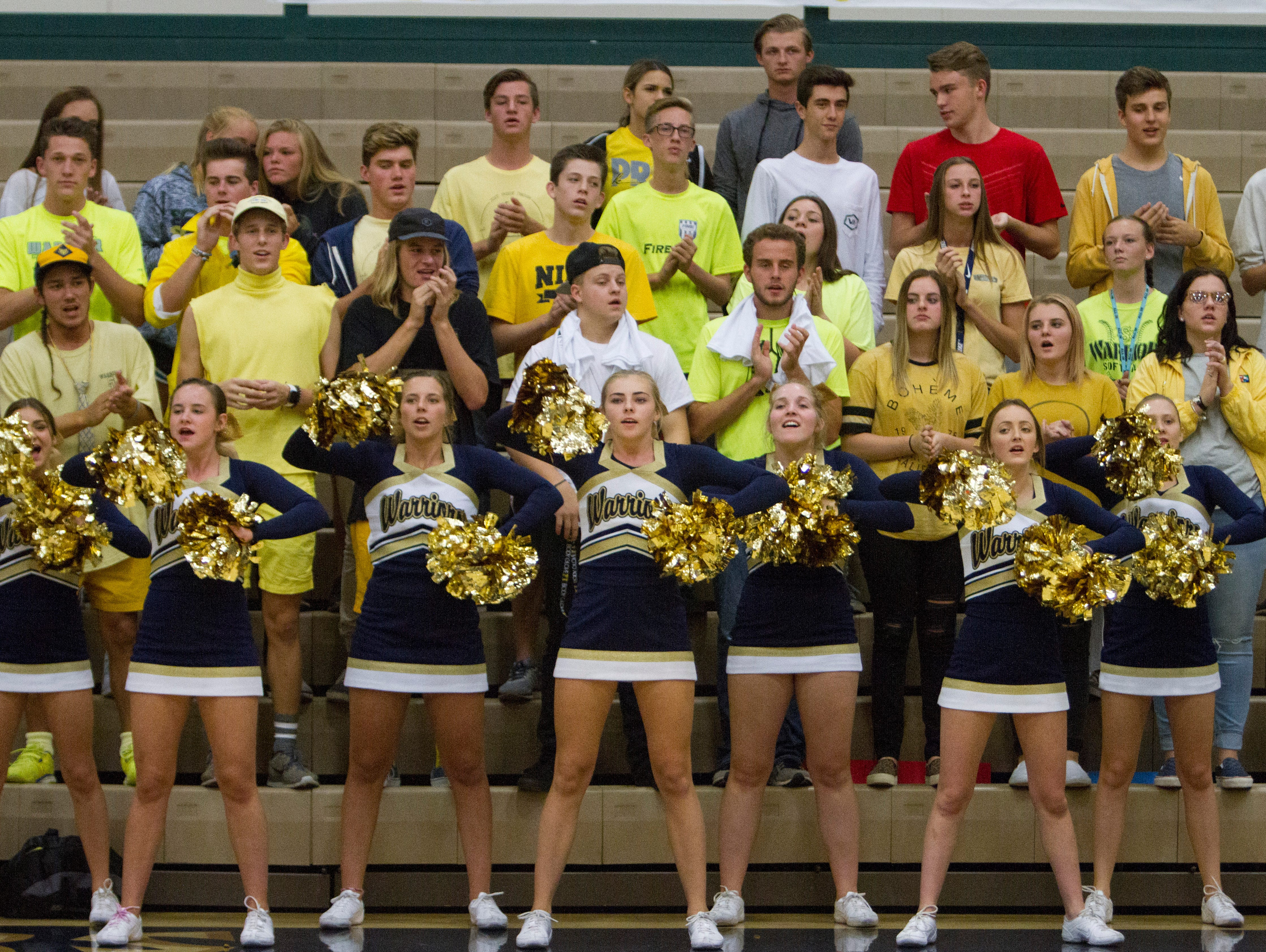 Members of the Snow Canyon High School student body wear yellow shirts in support of Mackayla Marshall, the daughter of Hurricane High volleyball coach Content Marshall and who was recently diagnosed with cancer Thursday, Sept. 22, 2016.