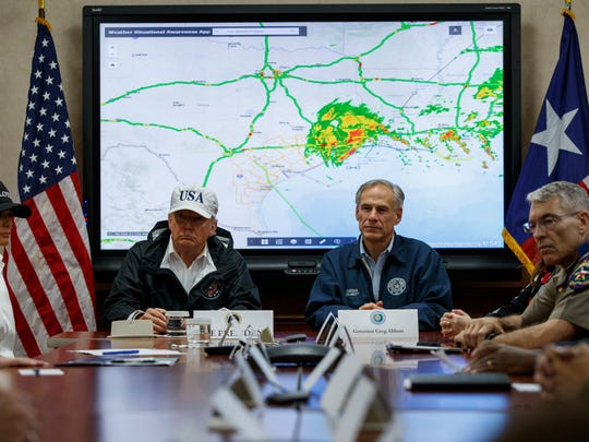 President Donald Trump, accompanied by Texas Gov. Greg Abbott, speaks during a briefing on Harvey relief efforts, Tuesday, Aug. 29, 2017, at the the Texas Department of Public Safety Emergency Operations Center in Austin.