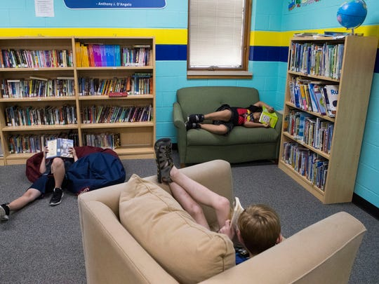 Children read at The Boys & Girls Club of the Sioux
