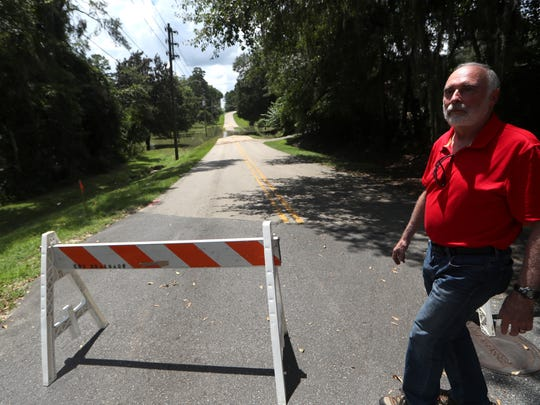 Terry Ryan, a resident of the Stonegate neighborhood for 22 years, says he has only seen Fleischmann Lane flood a couple times in the last two decades, but that has changed as the new Canopy at Welaunee development has moved in to the area, forcing untreated water to flood the low-lying, adjacent street.