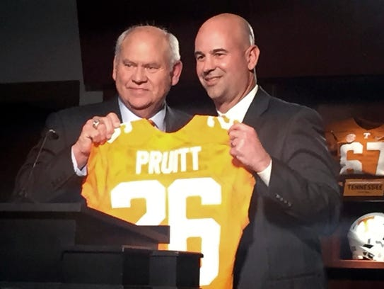 New Tennessee football coach Jeremy Pruitt, right,