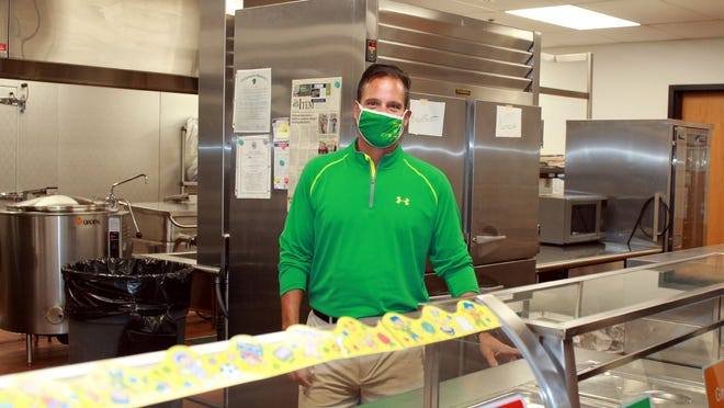 Clinton Schools Food Service Director David Vanasse behind the line in the Clinton Elementary School cafeteria.