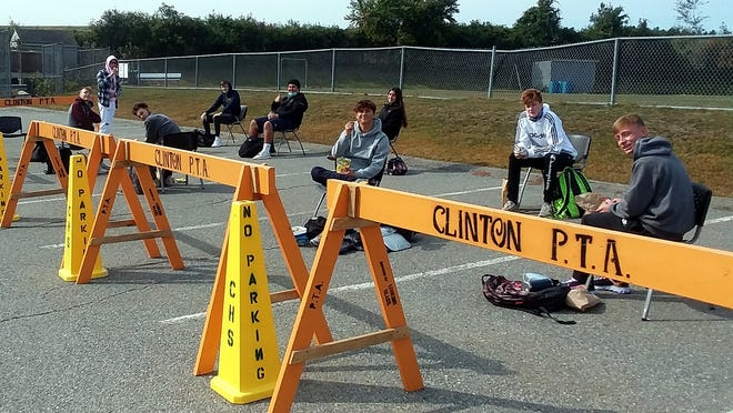 Clinton High students enjoy a socially-distanced lunch outside.