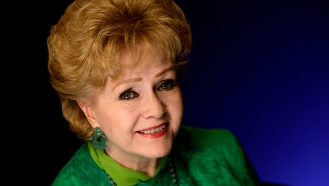 In this Oct. 14, 2011 file photo, actress Debbie Reynolds poses for a portrait in New York.