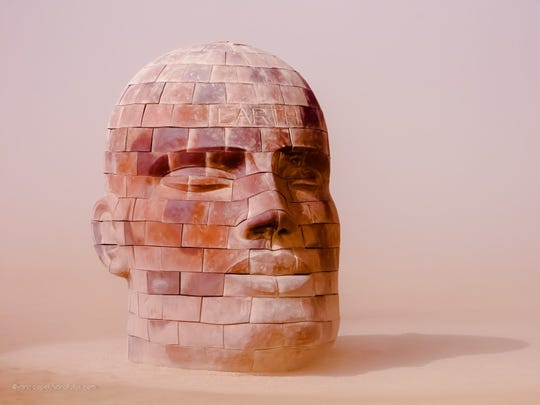 Artist James Tyler is best known for his large scale brickhead sculptures.