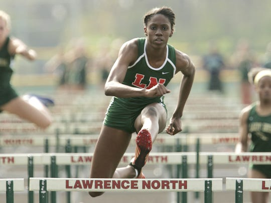 Lawrence North's Ashley Spencer has a large lead in the 100 meter hurdles during their meet against Cathedral  April 13, 2010.