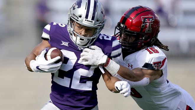 Texas Tech's Jacob Morgenstern (41) tries to tackle Kansas State running back Deuce Vaughn (22) during a Big 12 Conference game Saturday at Bill Snyder Family Stadium.