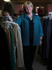 Vicky Cooke, executive director of the Delaware Breast Cancer Coalition, poses in Great Stuff Savvy Resale, the coalitions second-hand shop in Talleyville Shopping Center.