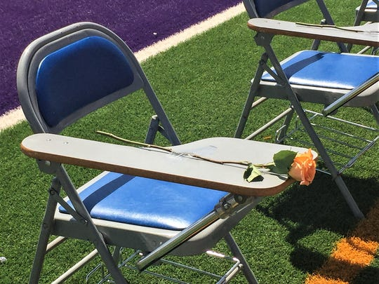 Thirteen roses were placed on empty seats in honor of the students slain at Columbine High School in Littleton, Colo.