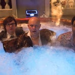 "In this image released by Paramount Pictures/MGM, Clark Duke, from left, Rob Corddry and Craig Robinson appear in a scene from ""Hot Tub Time Machine 2."""
