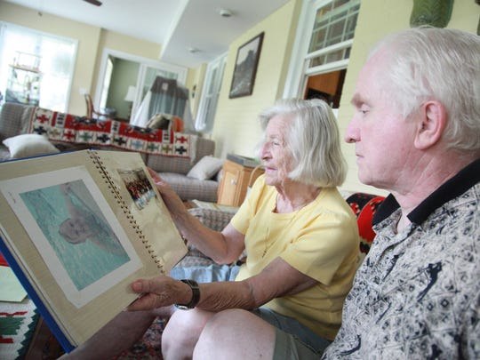 Erika and Ingold Hahn look through an album of Special