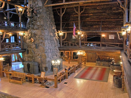 The Old Faithful Inn in Yellowstone National Park is one of the largest log buildings in the world. Its main lobby is centered on a massive lava-stone fireplace that measures 16 feet square at the base and has four main hearths, one on each face.