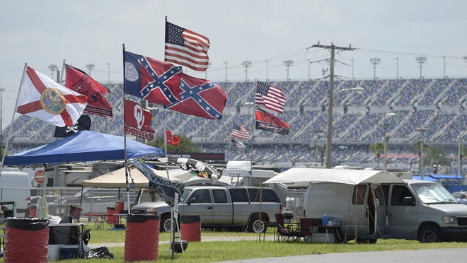 Confederate, American and other flags fly on top of motor homes at Daytona International Speedway, Saturday, July 4, 2015, in Daytona Beach, Fla. NASCAR and the speedway offered to replace any flag a race brings to the track with an American flag.