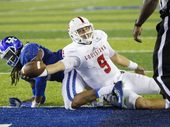 UL quarterback Brooks Haack unsuccessfully tries to