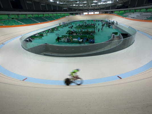 A cyclist rides his bike during a test event at the new velodrome, the last venue of the Rio 2016 Olympic Park to be delivered, in Rio de Janeiro, Brazil, Sunday, June 26, 2016. Rio will become the first South American city to host the Summer Olympics. (AP Photo/Silvia Izquierdo)