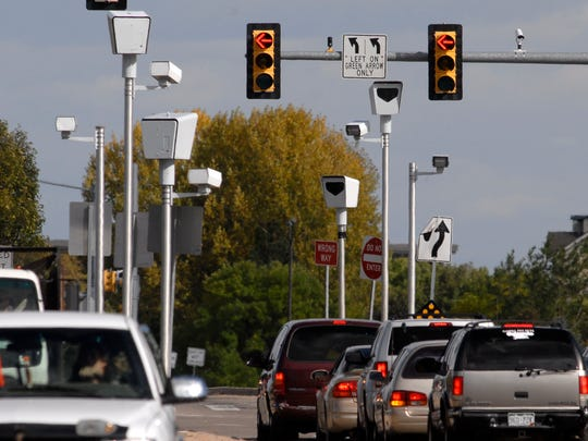 The red light camera stands on the east and west ends of the intersection of Harmony Road and Timberline Road in 2011.