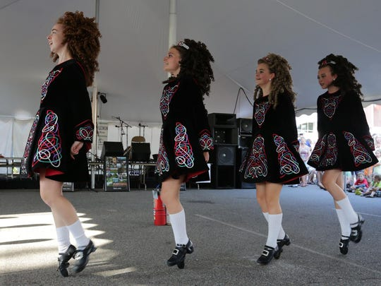Dancers from the Rince na Chroi School of Irish Dance kick up their heels at Irish Fest in the Basil parking lot in Weston, Saturday, September 7, 2013.