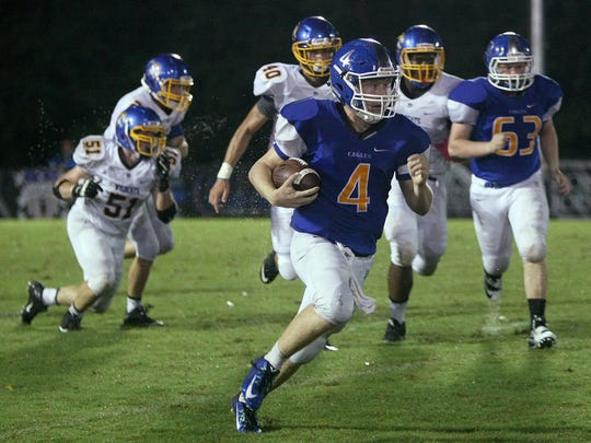 Jackson Christian's Will Buehler (4) runs with the ball against Donelson Christian Academy at Ronnie Fowler Field on Friday.