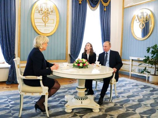 Russian President Vladimir Putin, right, speaks to French far-right presidential candidate Marine Le Pen, left, in the Kremlin in Moscow, Russia, Friday, March 24, 2017. Putin has held a surprise meeting with France's far-right presidential candidate and dismissed suggestions that Russia aims to influence the election in her favor.