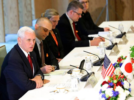 U.S. Vice President Mike Pence, left, speaks with Japanese Deputy Prime Minister and Finance Minister Taro Aso, not in picture, during the Japan-U.S. Economic Dialogue at the prime minister's office in Tokyo, Tuesday, April 18, 2017.