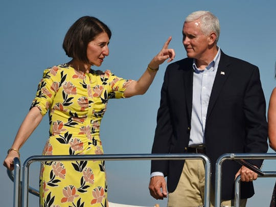 U.S. Vice President Mike Pence, right, chats with New South Wales Premier Gladys Berejiklian during a cruise on the harbor in Sydney, Sunday, April 23, 2017. Pence is on the last part of his four-country trip to Asia and Australia.