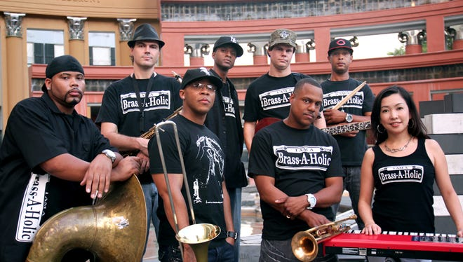 Brass-A-Holics are, from bottom left, Jason Slack (bass horn), Winston Turner (trombone), Tannon Williams (trumpet), Keiko Komaki (piano), and from top left, Robin Clabby (saxophone), Dwayne Muhammad (percussion), Matt Clark (guitar) and Rickey Caesar (drums).