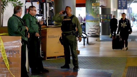 Broward Sheriffs' Deputies stand guard outside the