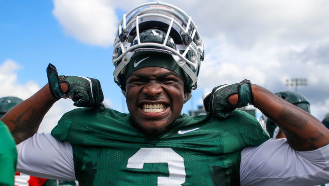 MSU running back LJ Scott is fired up during football practice Friday, August 4, 2017.