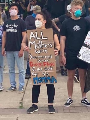 In this uncredited Facebook photo that was posted last week by Twitter user @Tamara_Harumi, an unnamed protester's sign speaks volumes about the universal outrage sparked by the May 25 death of George Floyd. Four now-fired Minneapolis Police Department officers have been charged in Floyd's death.