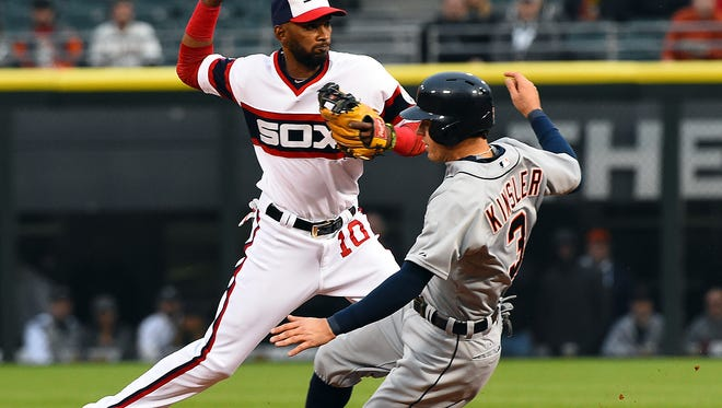 White Sox shortstop Alexei Ramirez (10) makes a double play against Tigers second baseman Ian Kinsler (3) during the first inning of the Tigers' loss Tuesday in Chicago.