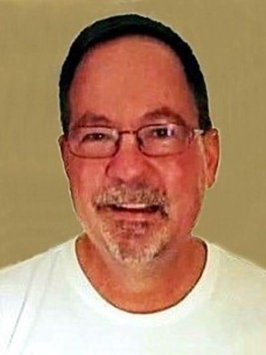 Mark L. Gardner