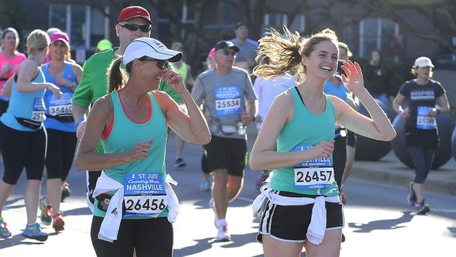 Runners run through the course during the Country Music Marathon Saturday April 26, 2014, in Nashville, TN.