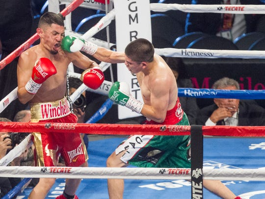 Diego De La Hoya, in green-and-white striped shorts,
