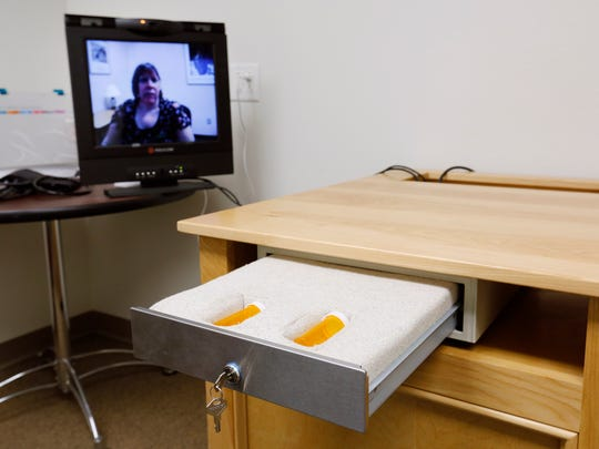 Dr. Jill Meadows, Planned Parenthood medical director, on monitor, demonstrates use of the telemedicine system. The system is used for dispensing abortion pills to patients in outlying clinics.