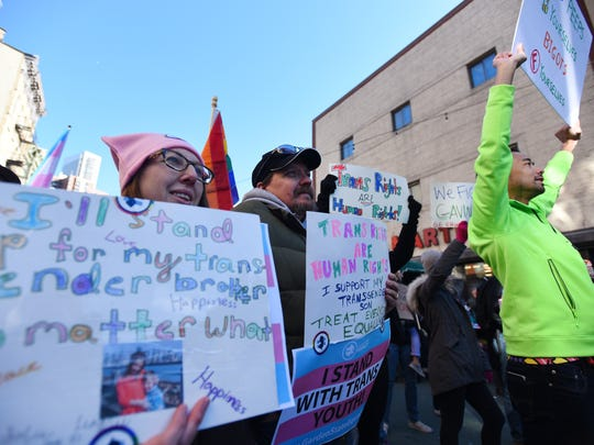 Participants including Brian Lee, right, of Somerset at the transgender rally in Jersey City on Sunday.