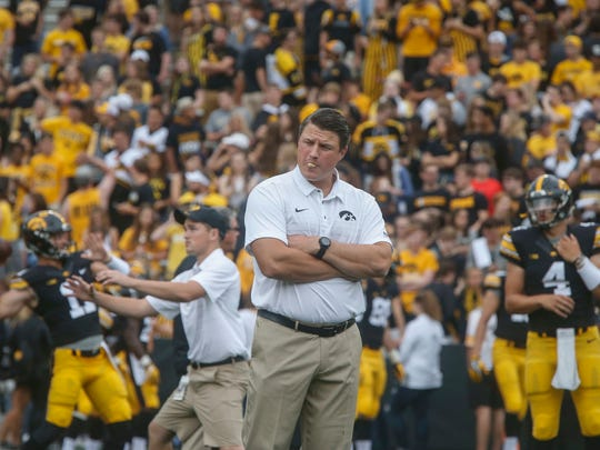 Iowa offensive coordinator Brian Ferentz watches his offense warm up prior to kickoff against Wyoming at Kinnick Stadium. Ferentz called plays from the press box.
