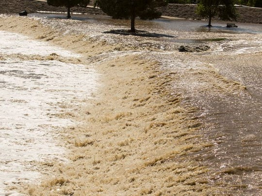 Water cascades down a breakwater in McKellips Lake Park on the Indian Bend Wash on Sept. 8, 2014.