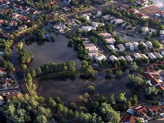 Flooding in the neighborhoods around US 60 and Stapely Dr. in Mesa, Sept. 9, 2014.