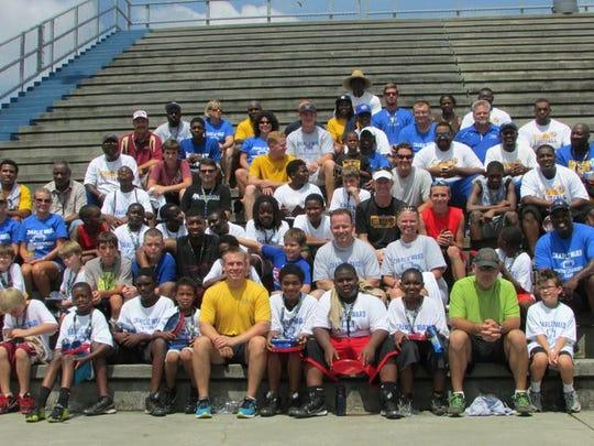 Participants at the Charlie Ward Mentor Leadership Camp at Washington High School, June 14, 2014.