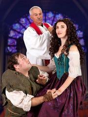 Claude Frollo (Steve Valvano) stands over Esmeralda