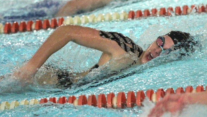 Lexington's Liv Merkel, competing in the 100 freestyle, helped her team win a repeat sectional swim championship.