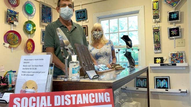 Artists Jack Schwab, and Debbie Wilger, wear their masks July 14 inside the Missouri Artists on Main store in downtown St. Charles. The store requires customers to wear masks but there is no county or city requirement and the St. Charles County director of elections has told poll workers to 'act surprised' if someone asks why no masks are being worn on election day.