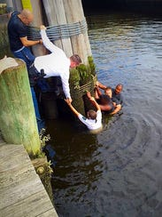 Salisbury police are shown rescuing a man who was trying
