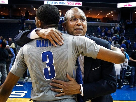 University of Memphis head coach Tubby Smith hugs guard