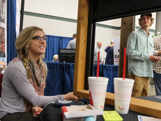 Kendall Crews, left, of Greer, watches an automatic screen display near Clay Groce, right, during The Upstate's Home & Garden Expo on Saturday at the Civic Center of Anderson.
