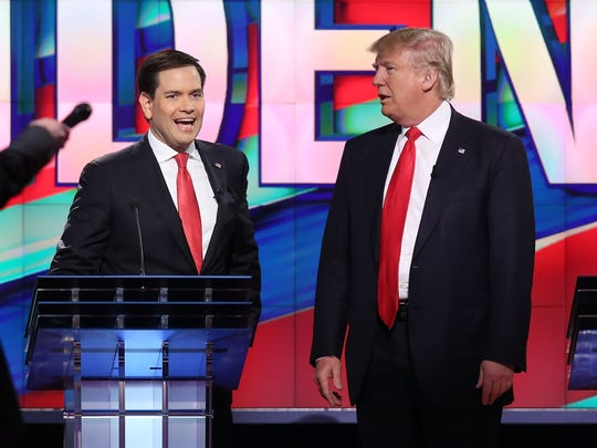 Then-GOP presidential candidates Marco Rubio and Donald