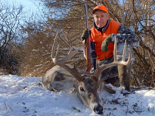Outdoor writer/photographer Charlie Alsheimer poses with his final white-tailed buck, which he shot Dec. 14 on his farm near Bath, New York.