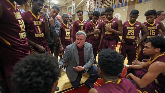Mount Vernon basketball coach Bob Cimmino talks to