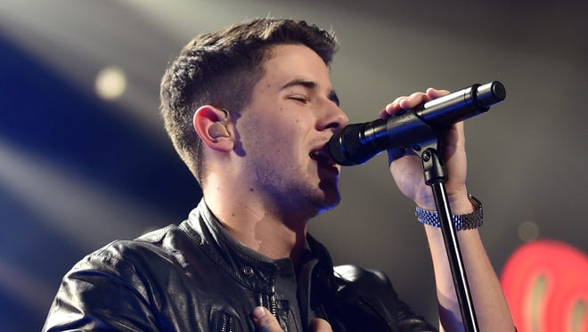 Nick Jonas performs at the KIIS FM's Jingle Ball at the Staples Center on Friday, Dec. 5, 2014, in Los Angeles. Jonas is joining forces with Jerry Lewis, Gavin DeGraw and other entertainers Wednesday to honor those who serve and support U.S. veterans and military families with a new award as many service members return from Iraq and Afghanistan.