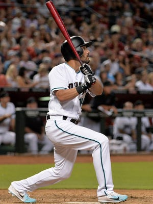 Arizona Diamondbacks outfielder Reymond Fuentes (14) hits a two run home run in the fifth inning against the San Diego Padres at Chase Field.